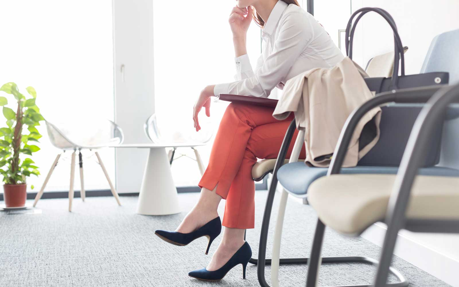 Businesswoman waiting with legs crossed in lobby