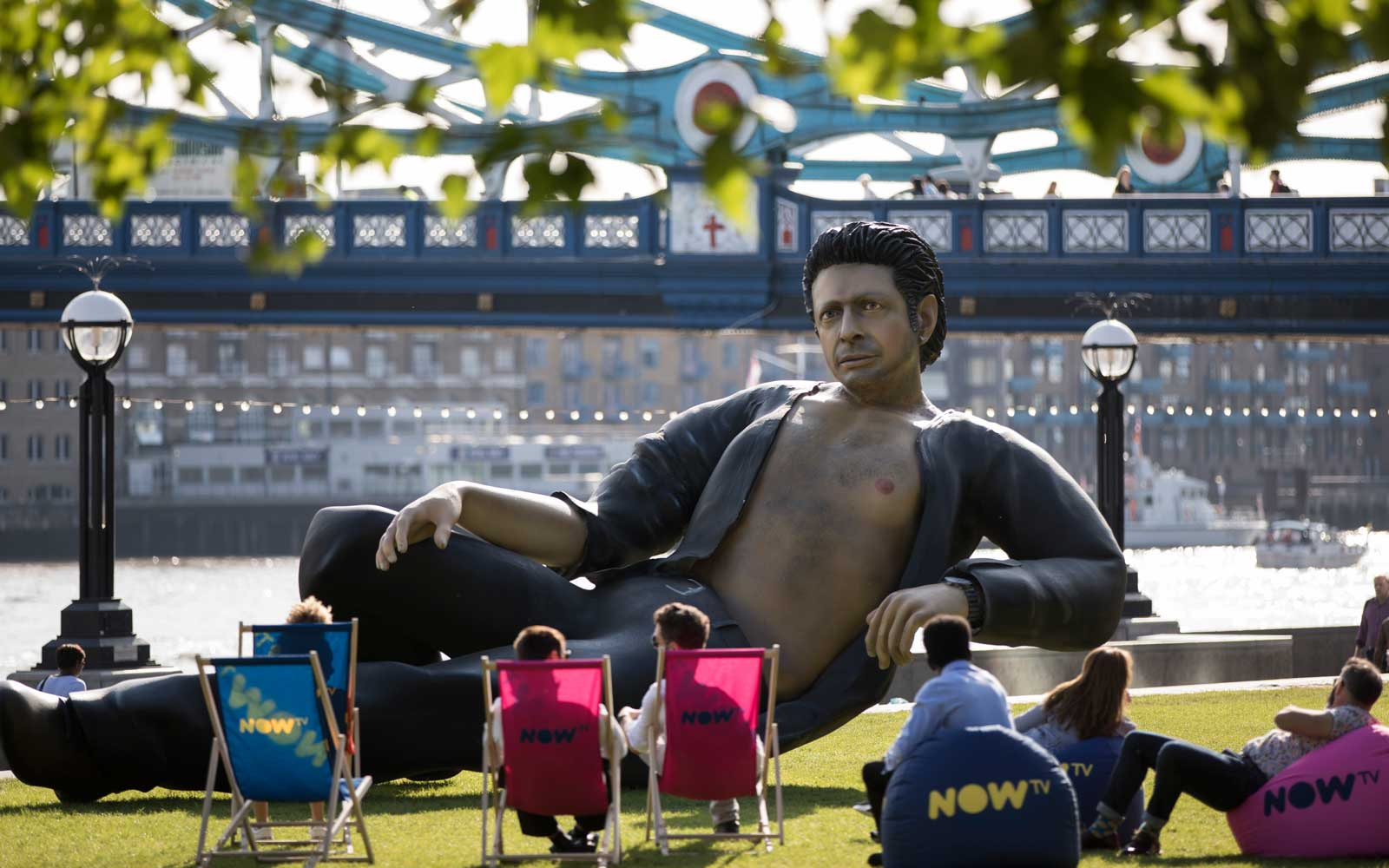 Celebrating 25 years since Jurassic Park first premiered in the UK, streaming service NOW TV unveil a statue of Jeff Goldblum semi-naked torso at Potters Field on July 18, 2018 in London, England