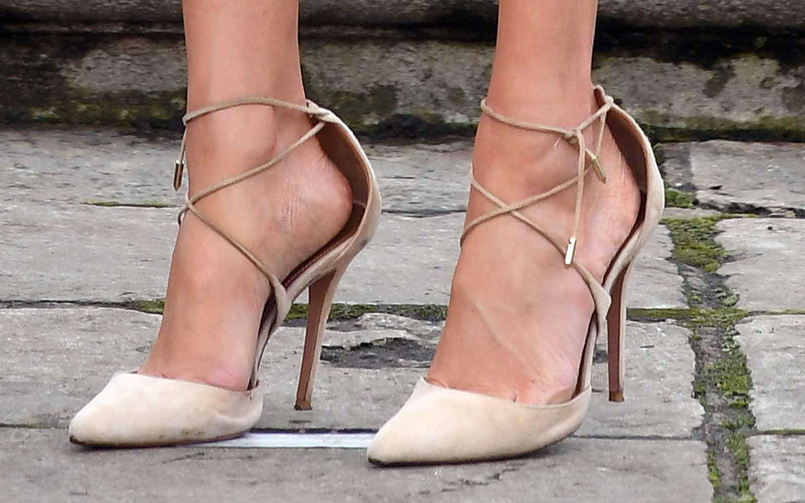 Meghan Markle, shoe detail, attends an official photocall to announce the engagement of Prince Harry
