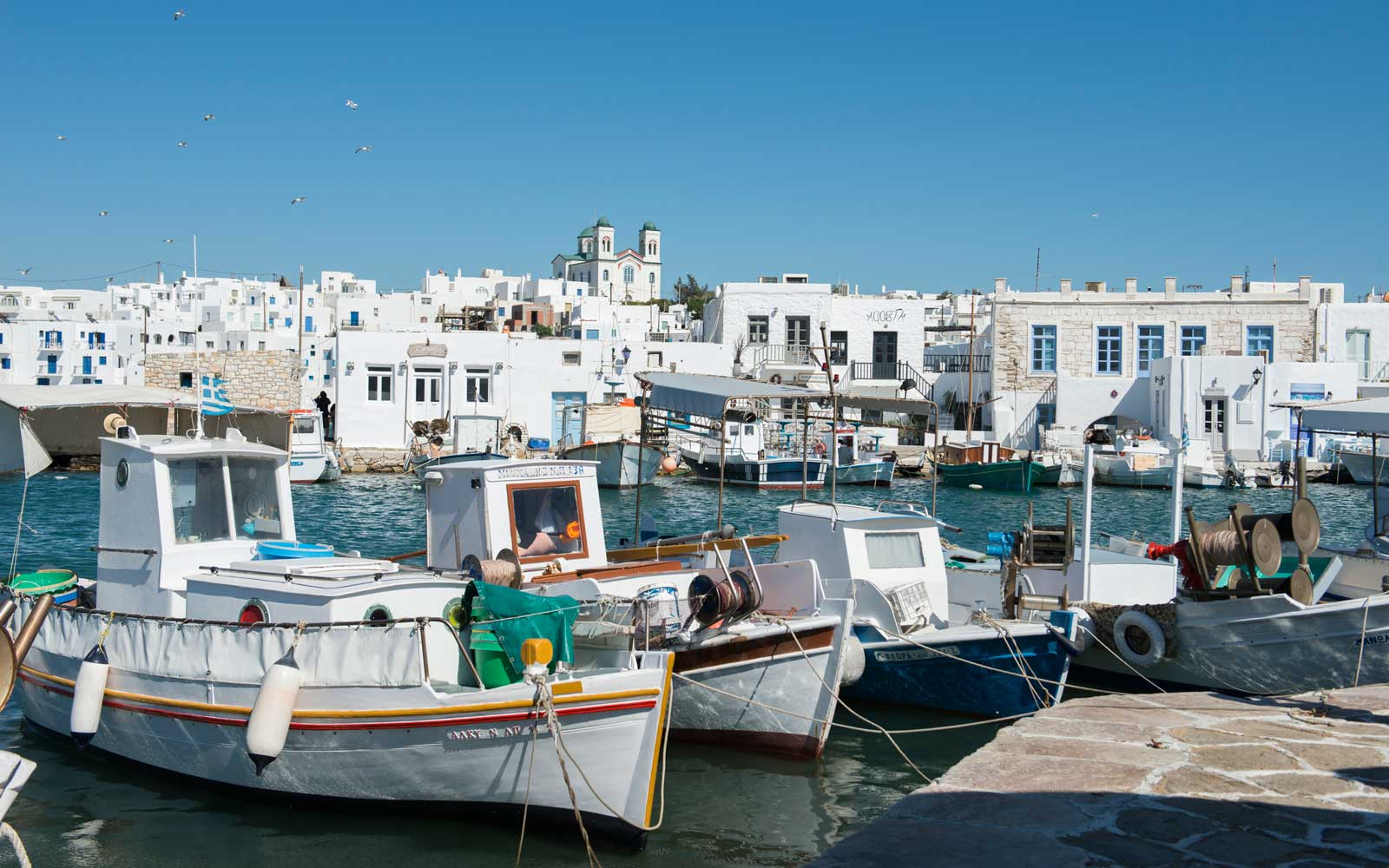 Boats moored on the waterfront at Naoussa, Paros, The Cycaldes, Greece