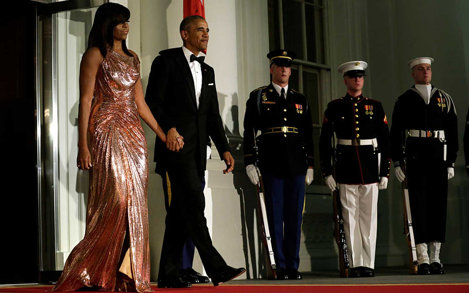 US President Barack Obama and First Lady Michelle Obama walk out to welcome Italian Prime Minister Matteo Renzi and his wife Agnese Landini on the North Portico of the White House before the state dinner in Washington