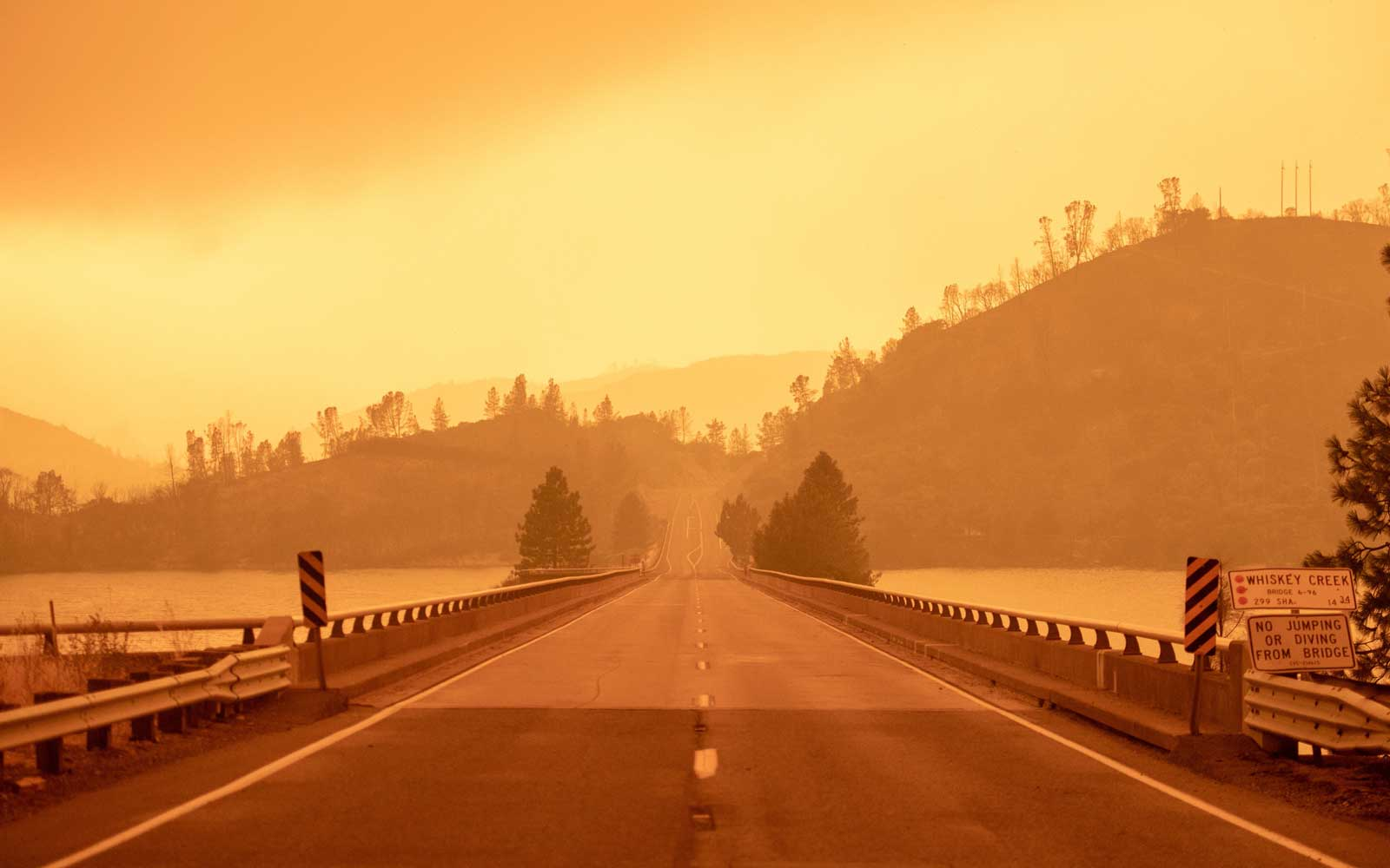The sky turns a deep orange as smoke fills the area during the Carr fire near Whiskeytown, California on July 27, 2018
