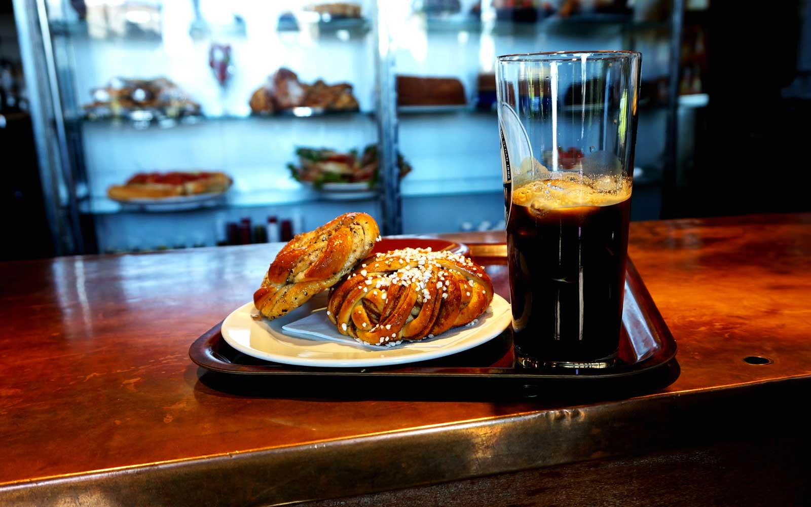 Cinnamon Buns And Black Coffee on a Cafe Counter in Stockholm