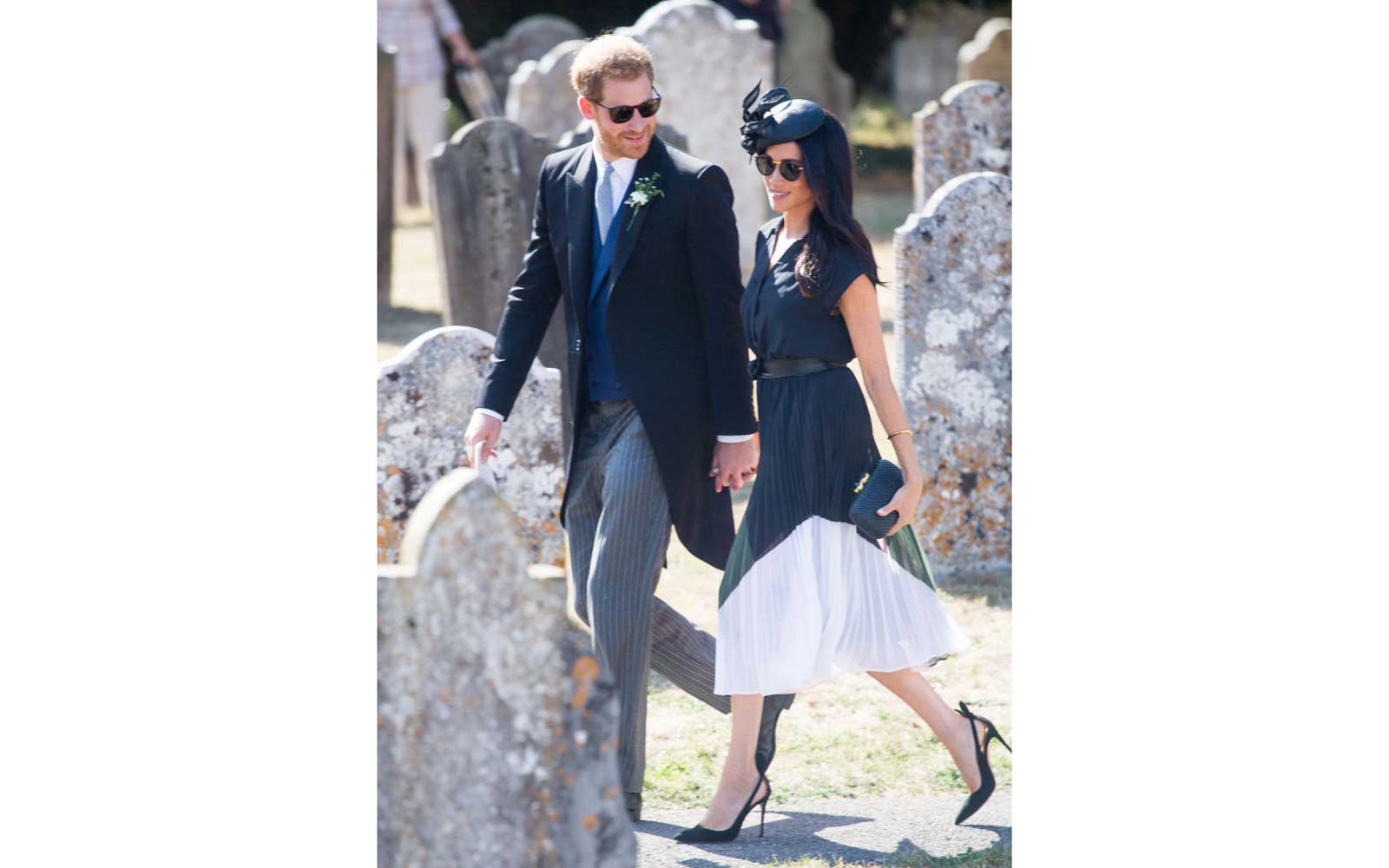 Prince Harry, Duke of Sussex and Meghan, Duchess of Sussex attend the wedding of Charlie Van Straubenzee