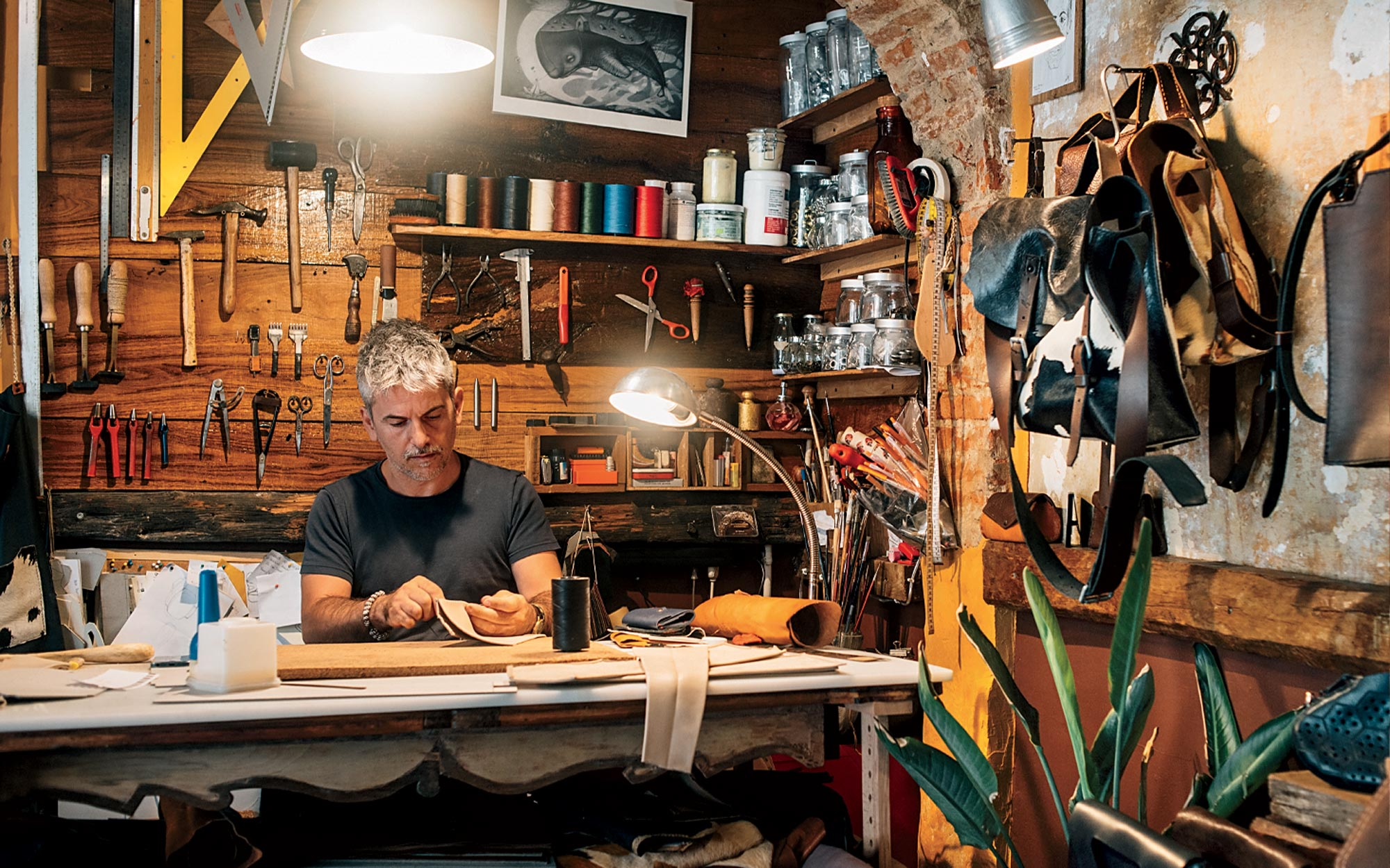 Mortegan, a leather artisan, at work in his studio in Florence, Itay