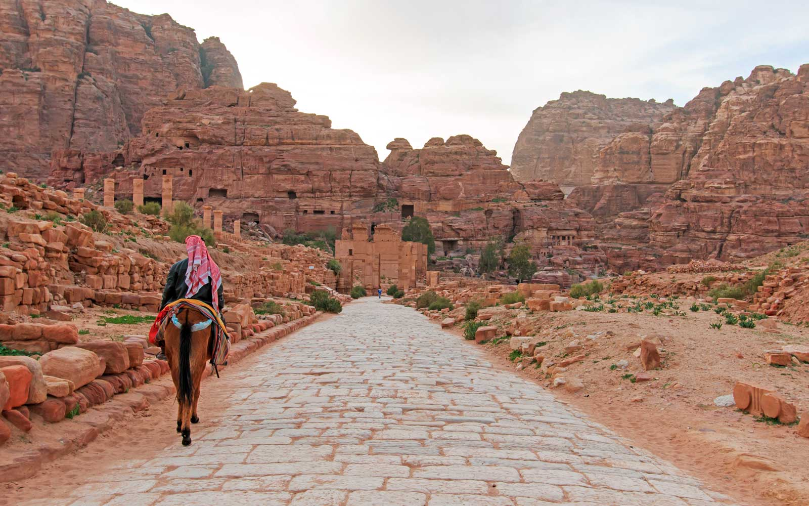 Tourist exploring the ruins of ancient Petra. Petra. UNESCO World Heritage Site. Jordan. Middle East