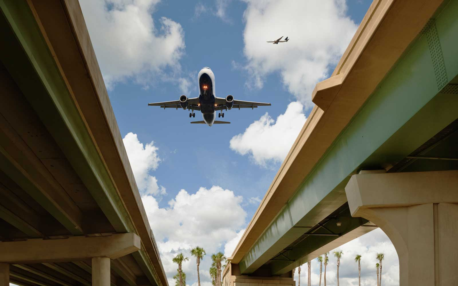 Airplanes flying over highway