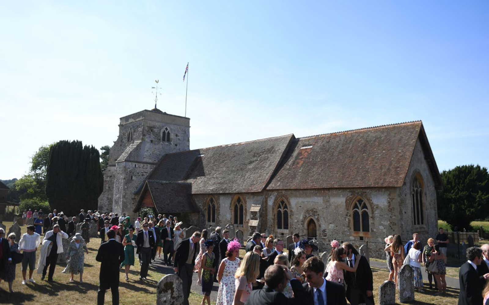 Guests outside St Mary the Virgin Church in Frensham, Surrey, after attending the wedding of Charlie van Straubenzee and Daisy Jenks