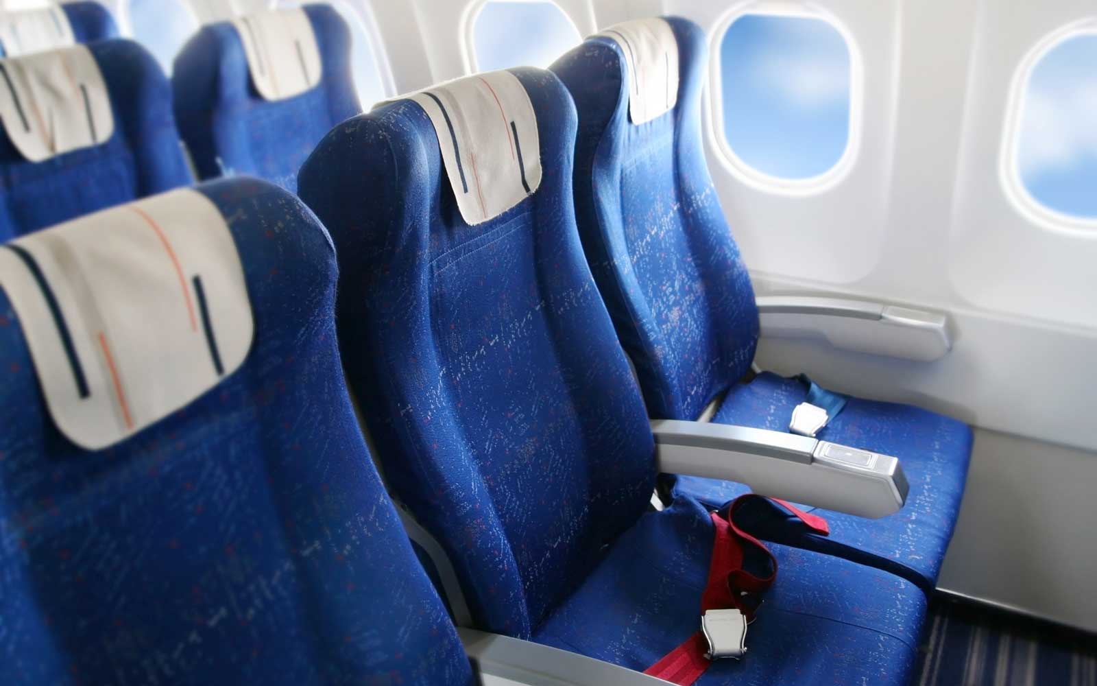 Row of seats in a commercial airplane cabin