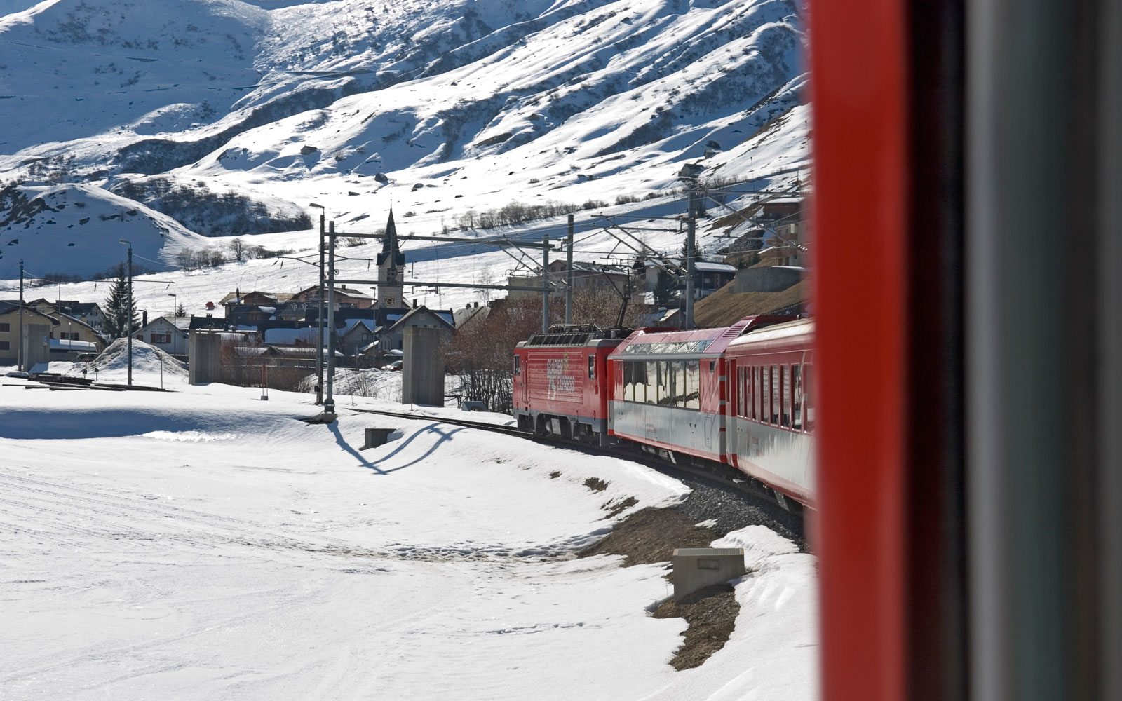 The Glacier Express train can be especially scenic when snow fills its route in the winter.
