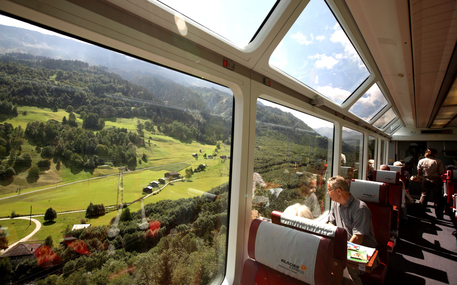The Glacier Express train comes with comes with large panoramic windows that reach its rood to let passengers admire the views.