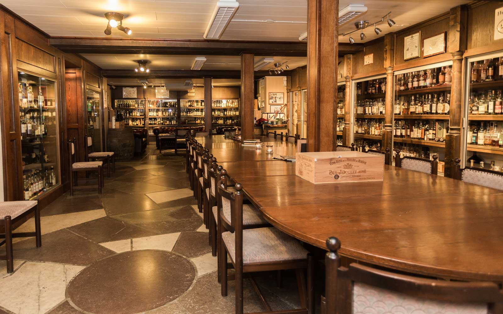 Hotel Skansen's whisky basement is illuminated with thousands of rare blends from around the world.