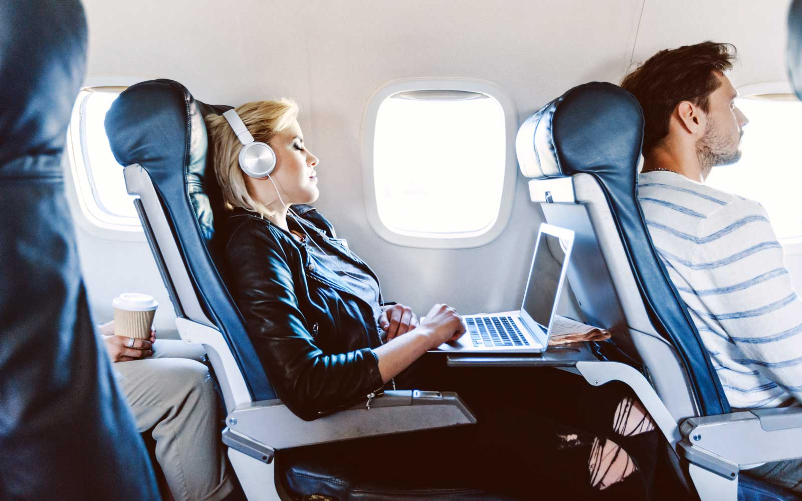 Female passenger using laptop during flight