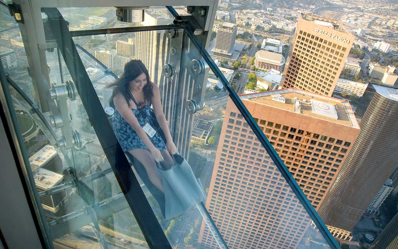 Guests travel down the Sky Slide during the OUE Skyspace LA ribbon cutting ceremony