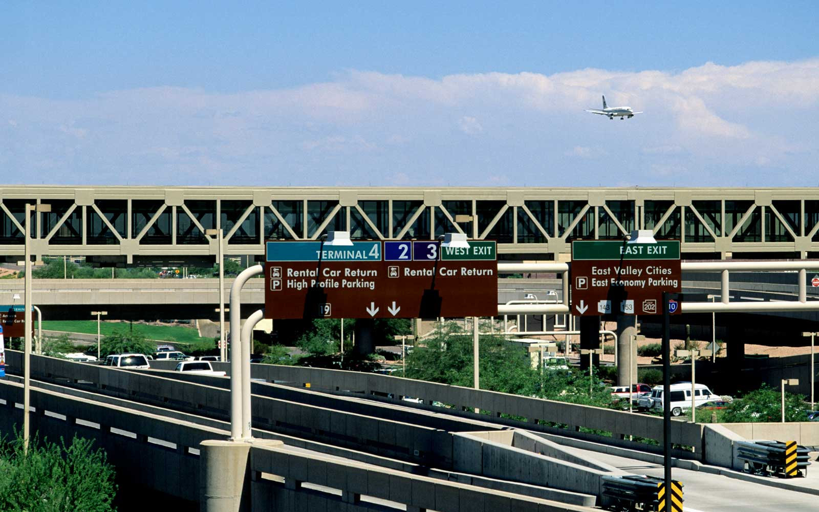 Aircraft over Phoenix Sky Harbor airport, with traffic signs