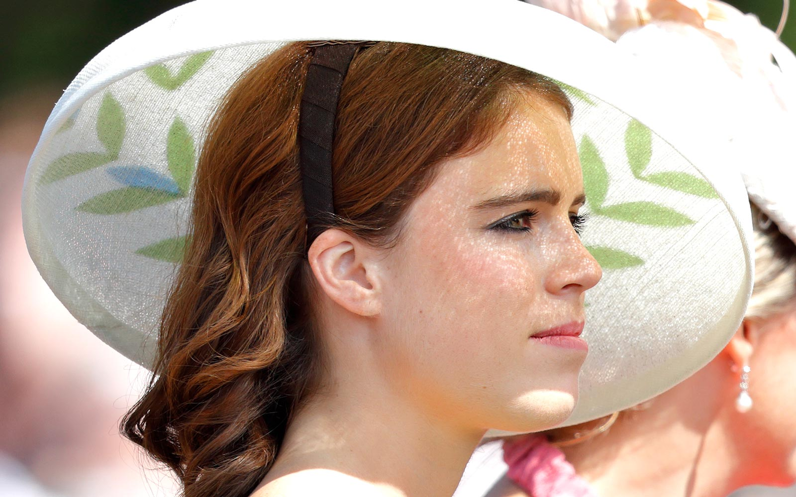 Princess Eugenie travels down The Mall in a horse drawn carriage during Trooping The Colour 2018 on June 9, 2018 in London, England.