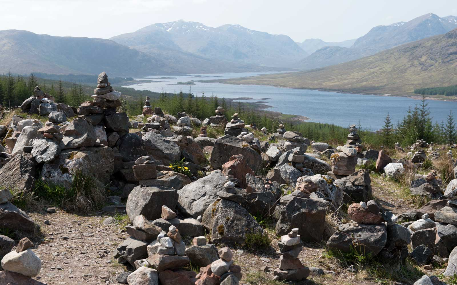 On top of a hill by the A87 trunk road from Invergarry to The Isle of Skye, there are hundreds of stone cairns, which have been constructed in an almost ritualistic way by passers by.