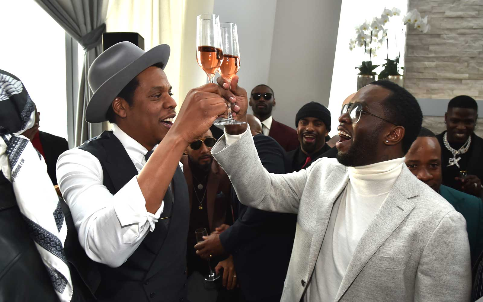 Jay-Z and P Diddy Toast Champagne