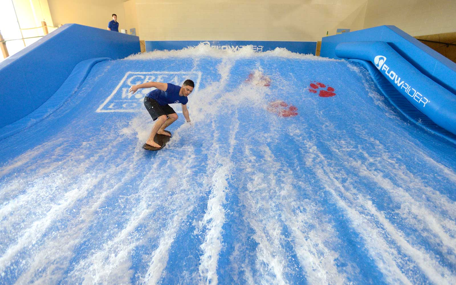 An aquatics supervisor at Great Wolf Lodge demonstrates the Wolf Rider Wipeout ride in Garden Grove.