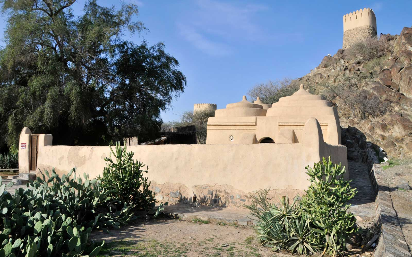 The emirate of Fujairah oldest mosque in the UAE at Badiyah with hill fort beyond also known as the Al Badiya