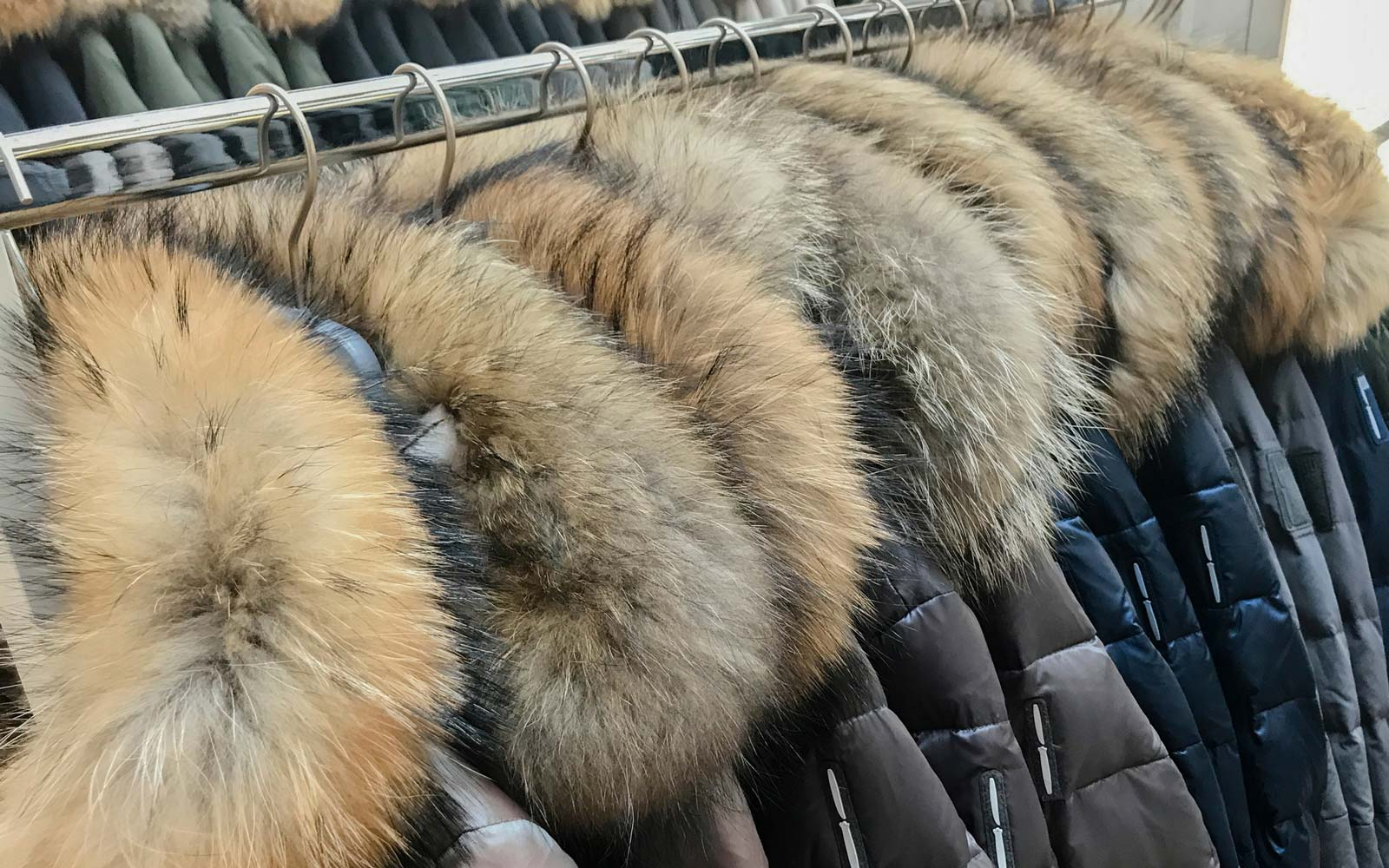 Close-Up Of Fur Coats Hanging On Rack