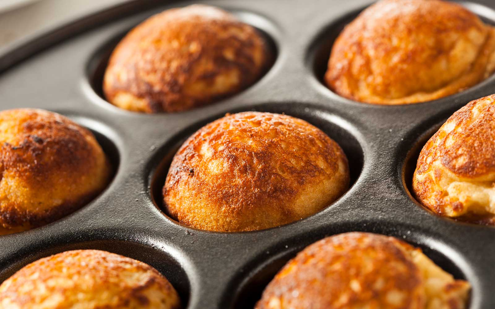 Aebleskiver are miniature pancake balls served in locations like Copenhagen.
