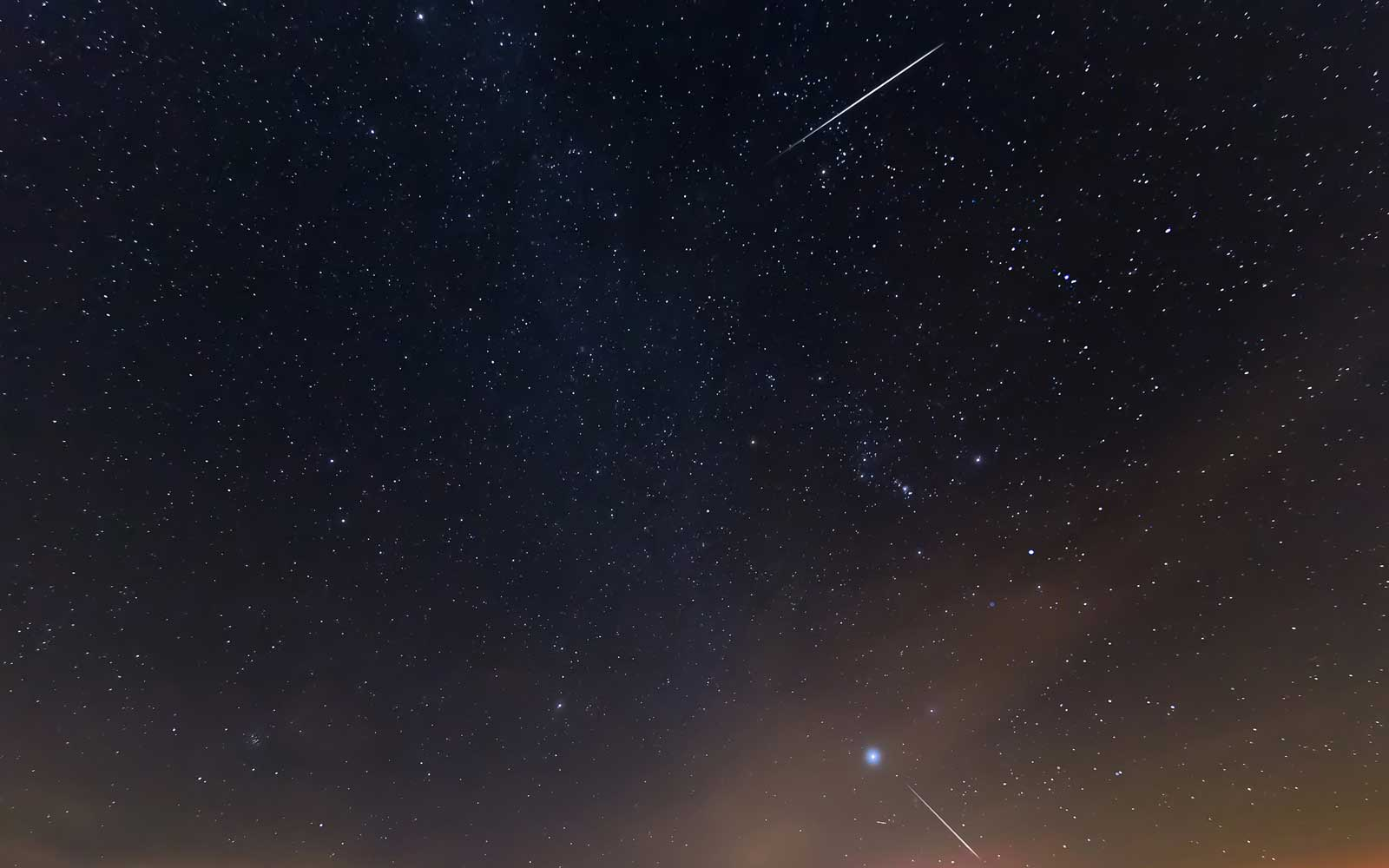 A meteor streaks across the night sky during the Geminid meteor shower over Murat Mountains in Gediz district of Kutahya, Turkey on December 14, 2017.