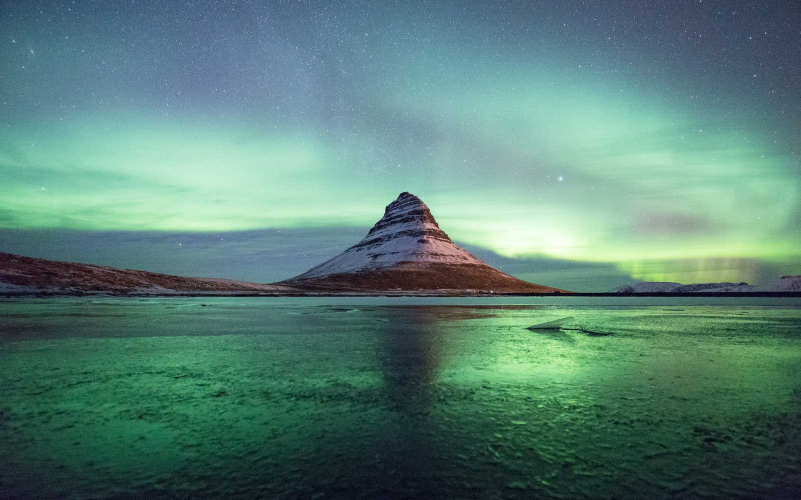 Aurora over Kirkjufell mountain, in Iceland