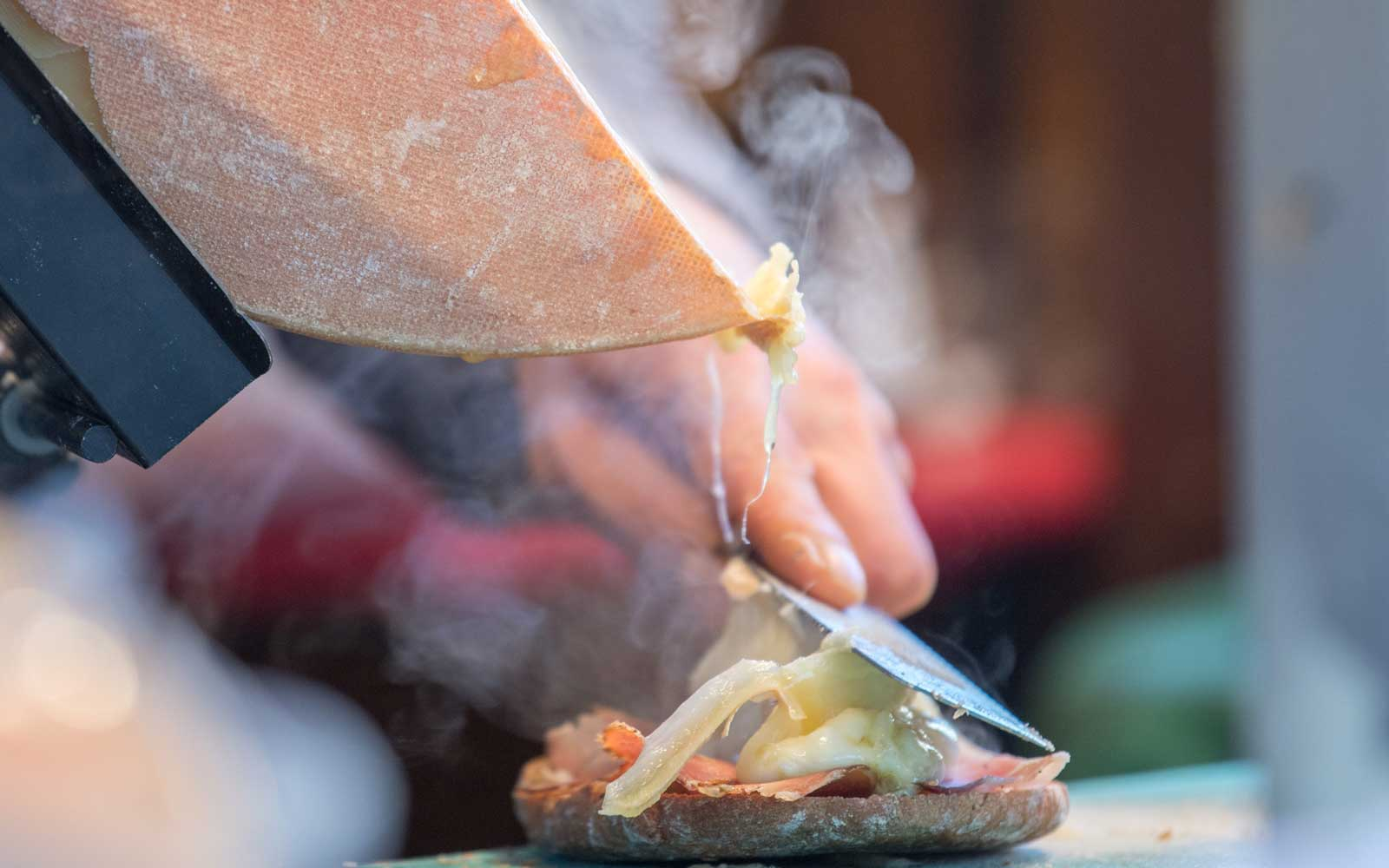 Raclette cheese is a specialty of Switzerland and is often melted and served hot over potatoes.