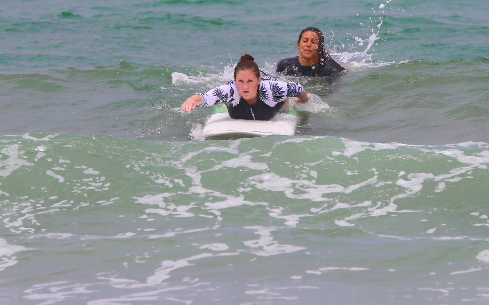 paddling into a wave