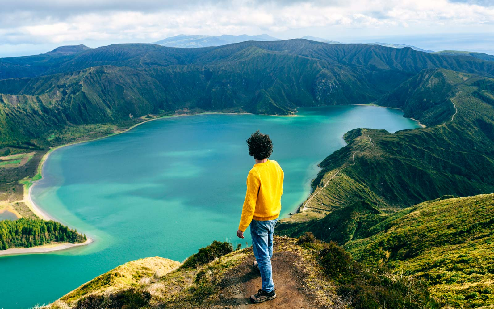 Azores, Sao Miguel, rear view of man looking at the Lagoa do Fogo
