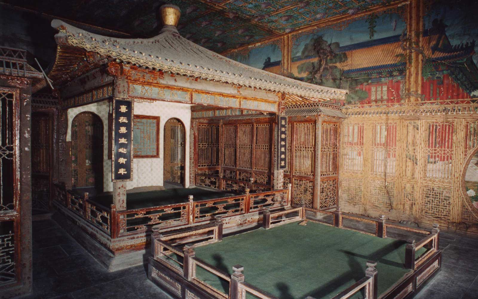 A photo of one of the interiors, the Juanqinzhai theater room, before conservation.