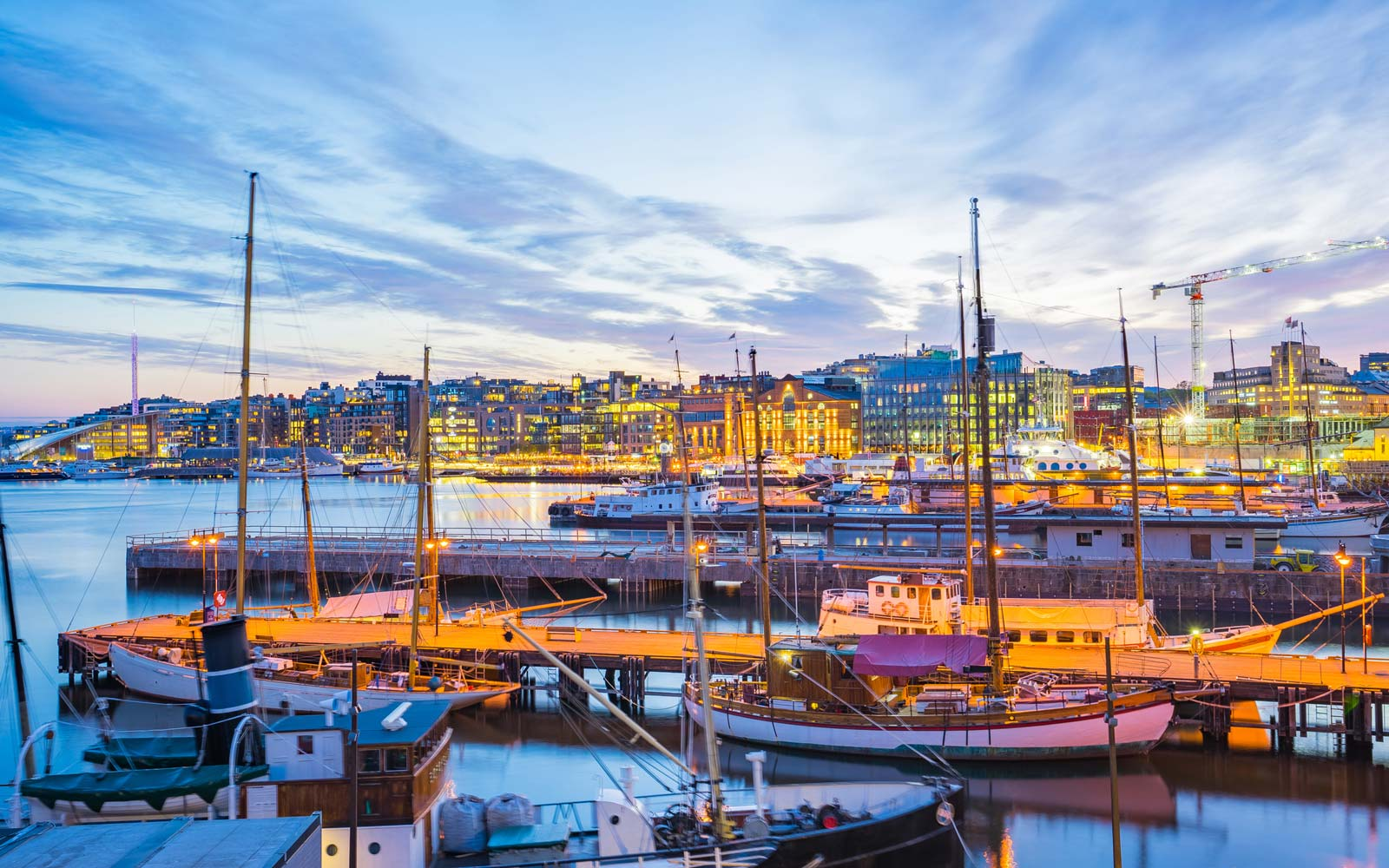 Oslo port with boats and yachts at twilight in Norway
