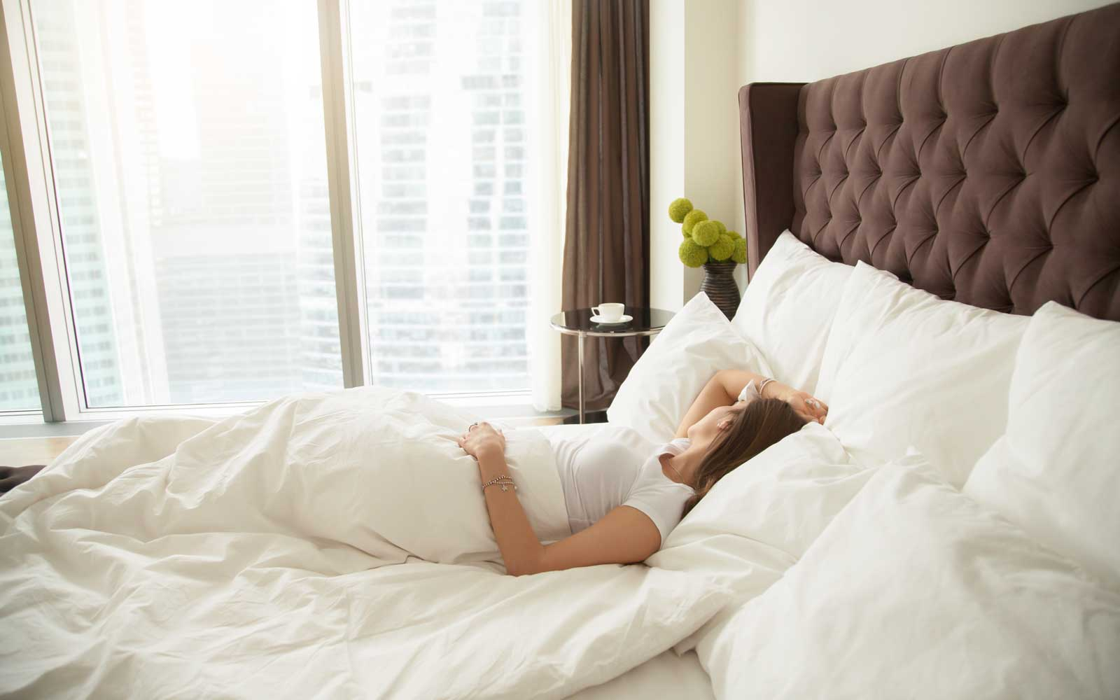 Woman sleeping in a hotel room
