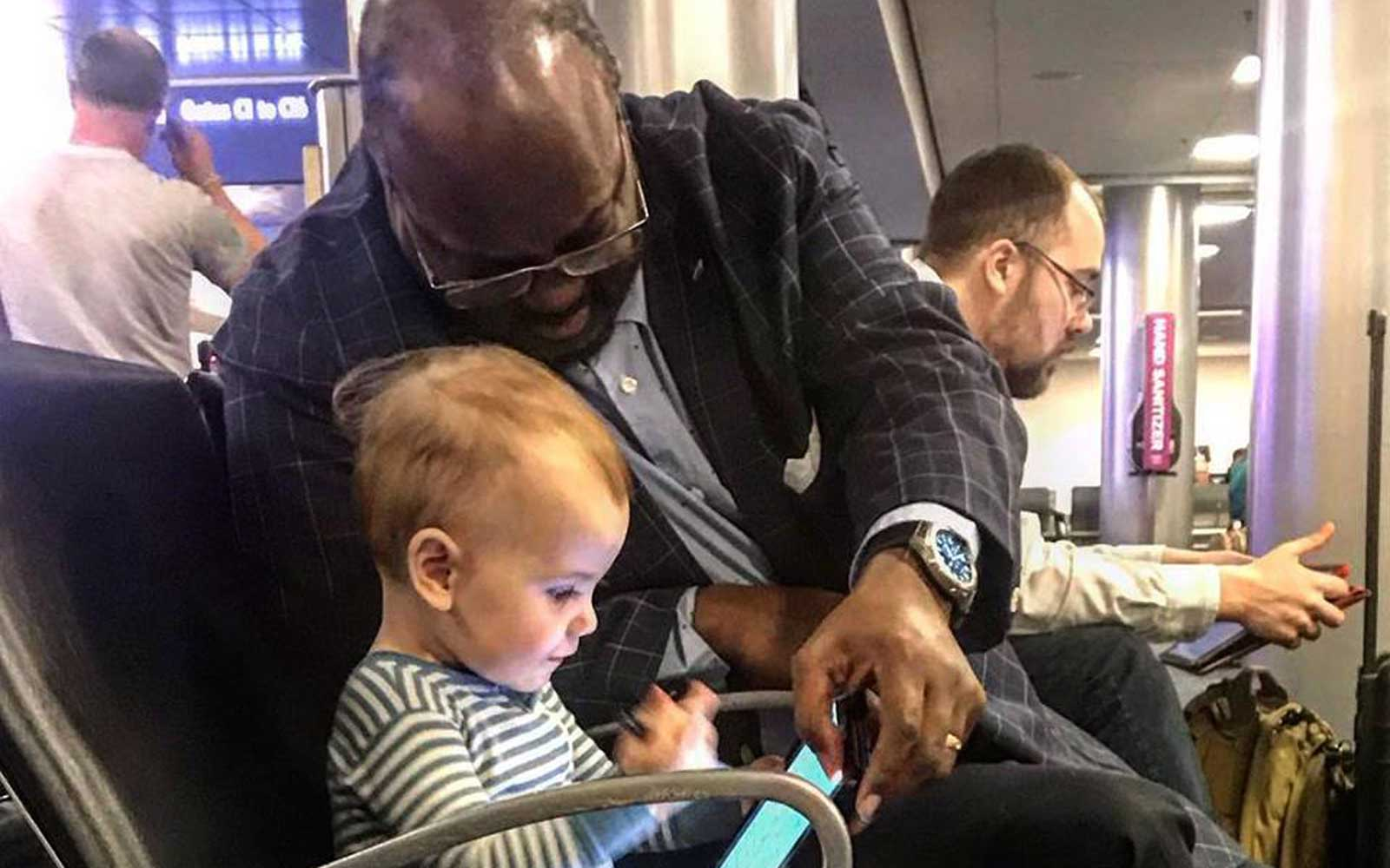 Kevin Armentrout's daughter, Carter Jean, and new friend at airport