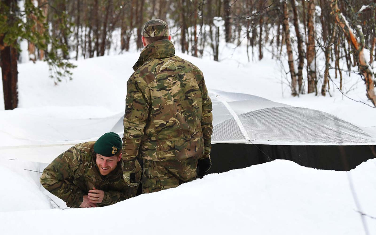 Prince Harry, Duke of Sussex exits a Quincey Shelter, a makeshift shelter built of snow