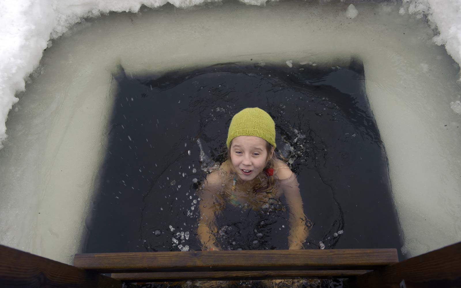 A girl bathes in icy water as she takes part in the European Sauna Marathon in Otepaeae, southern Estonia