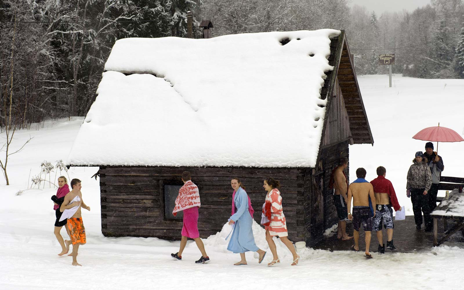 People take part in the European Sauna Marathon in Otepaeae, southern Estonia