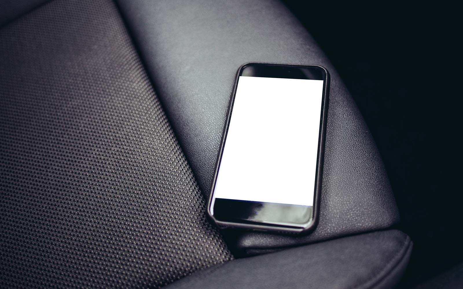 Close-Up Of Mobile Phone On Car Seat