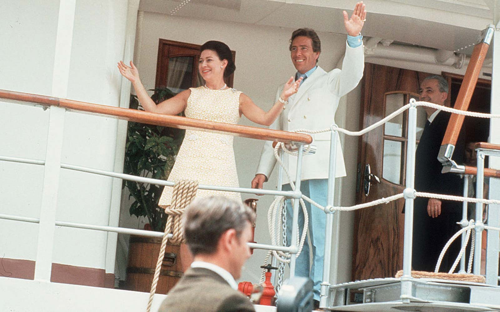 Princess Margaret and husband Tony Armstrong-Jones wave from the deck on the Royal Yacht Britannia during their 6-week Caribbean honeymoon cruise