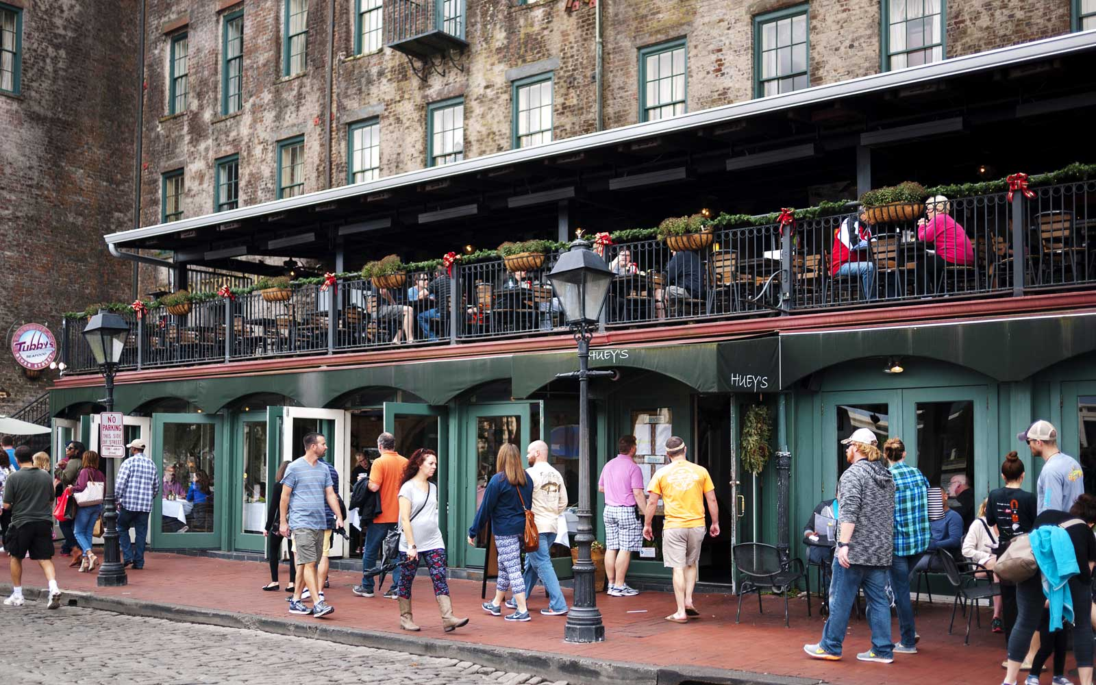 People walking on famous River Street, a cobblestone street along the south bank of the Savannah River