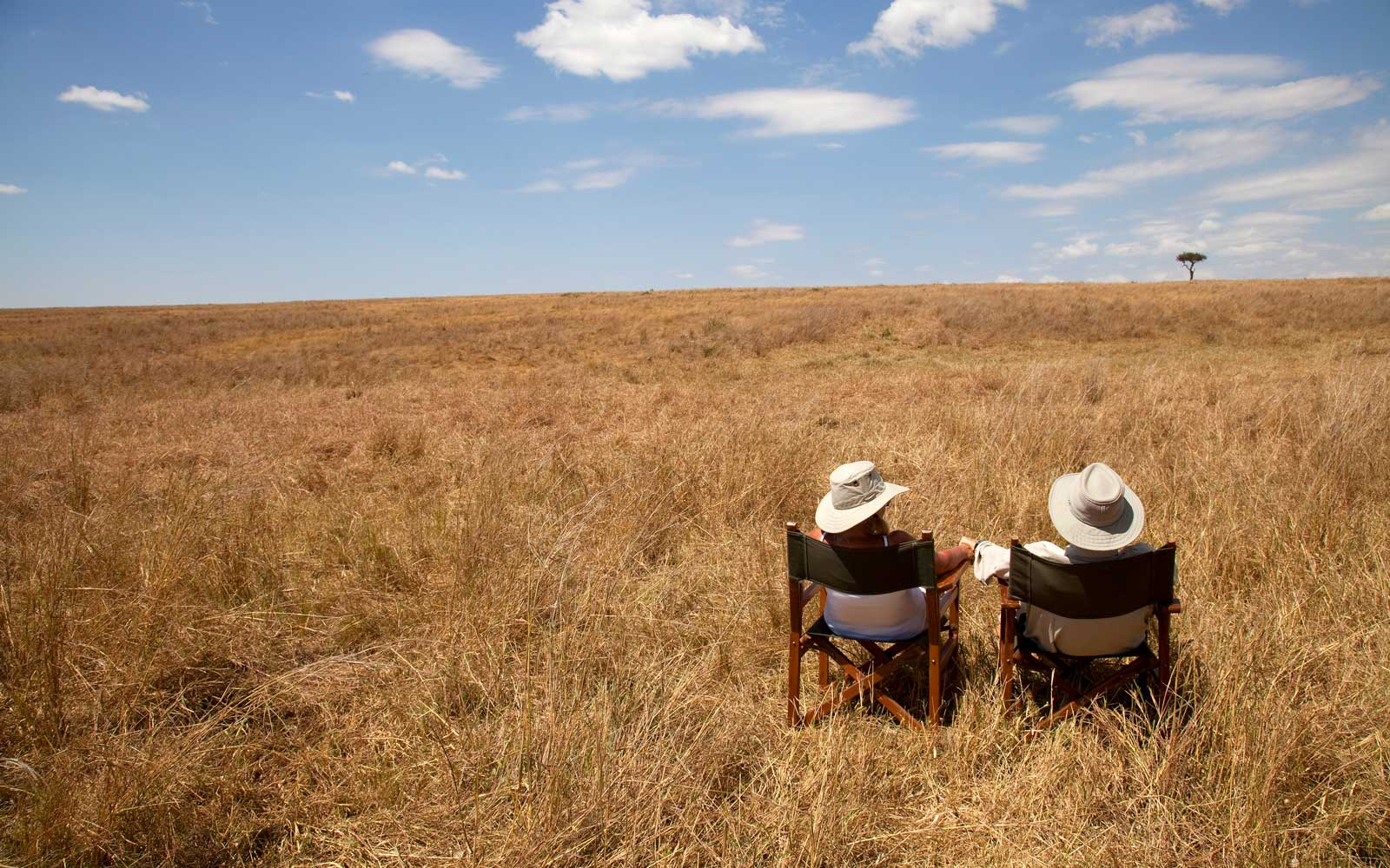 Couple on Safari, Maasai Mara National Reserve, Narok District, Kenya