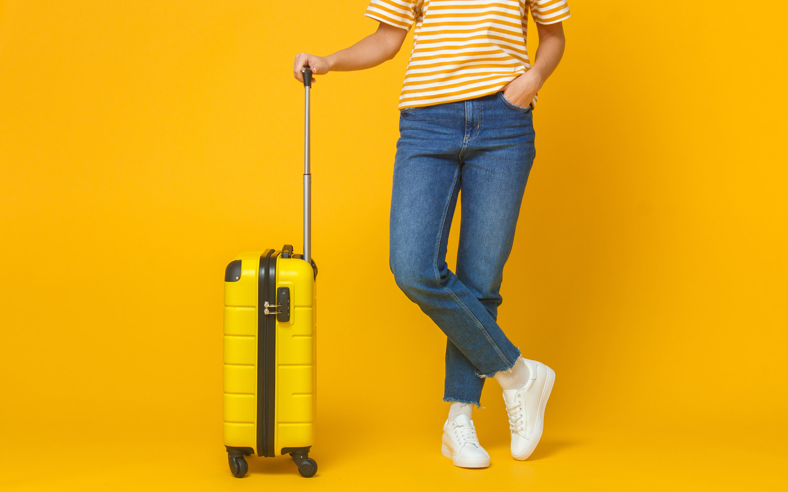 woman with colorful suitcase