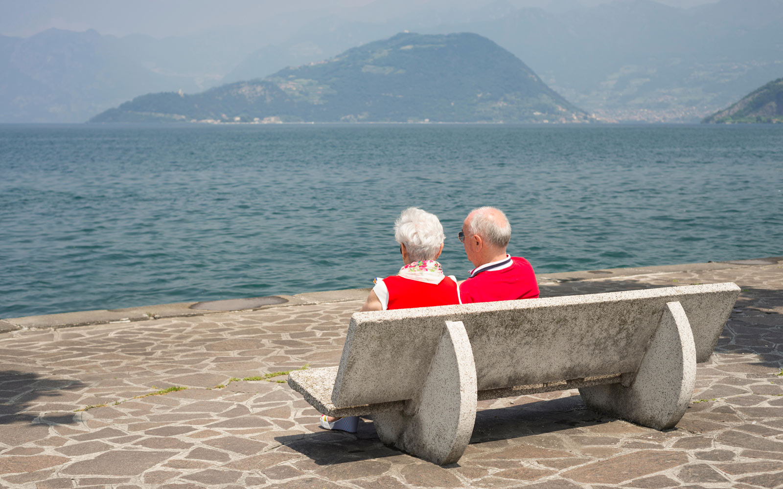 A Couple on a bench overlooking Lake Iseo
