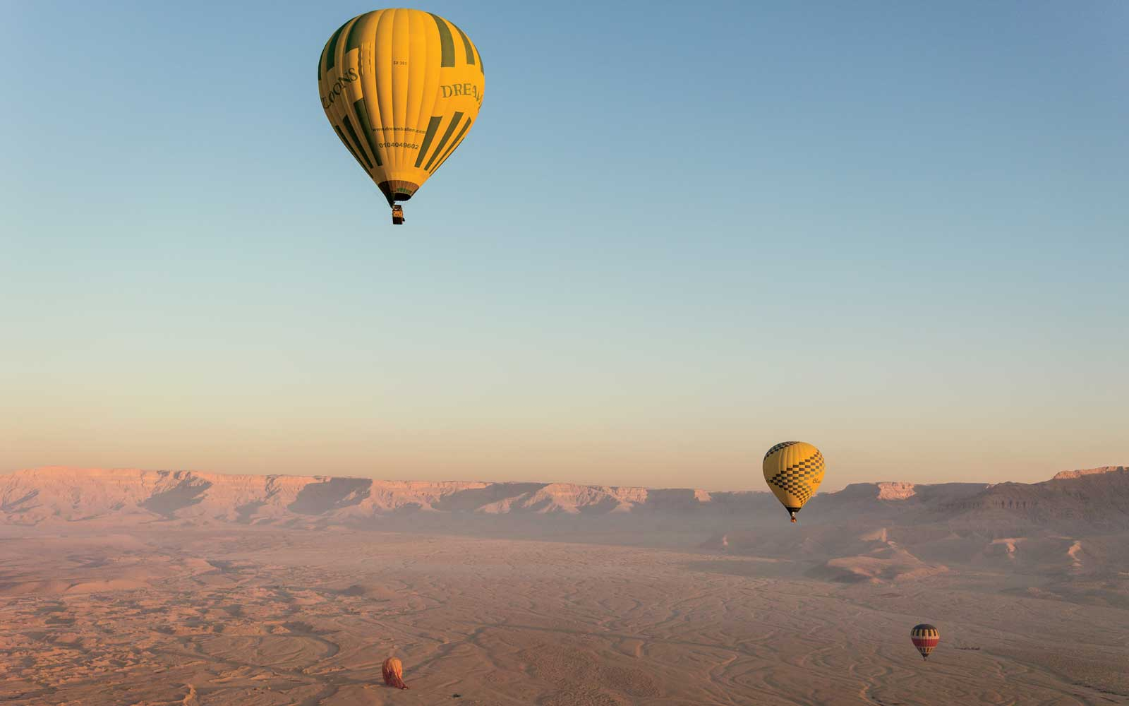 Hot air balloons over the Valley of the Kings in Luxor, Egypt