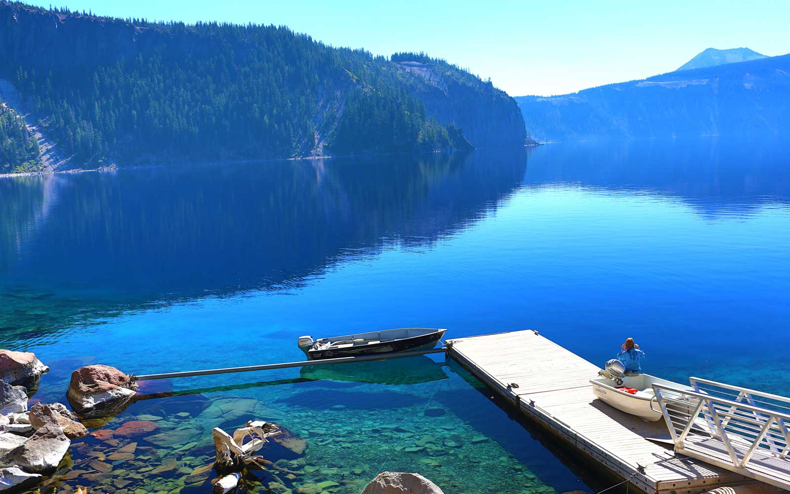 Visit Crater Lake National Park in the summer to take in the park's unique landscape and activities like hiking, boating, bicycling, and trolley tours.