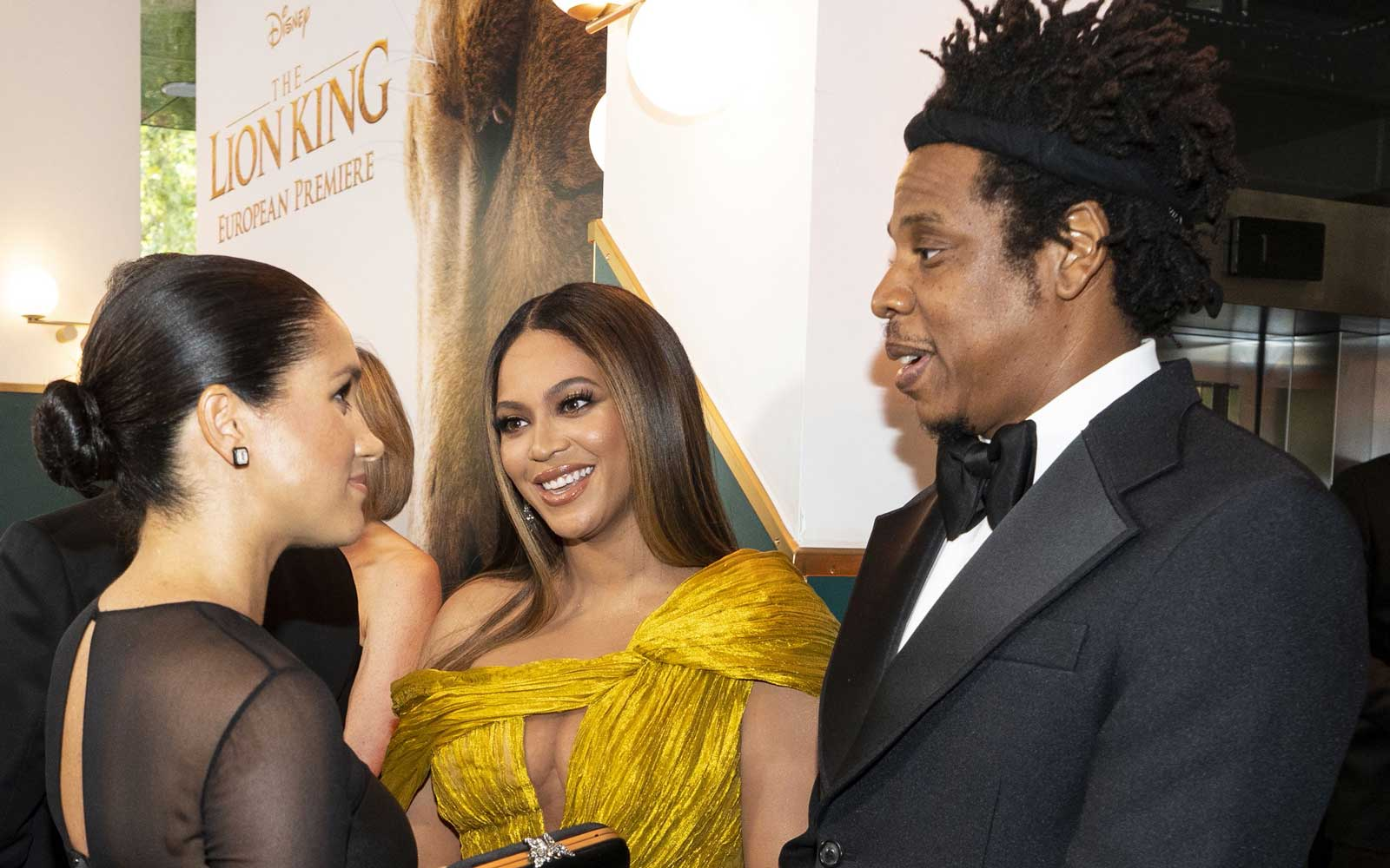 Meghan, Duchess of Sussex (L) meets cast and crew, including US singer-songwriter Beyoncé (C) and her husband, US rapper Jay-Z (R) as she attends the European premiere of the film The Lion King in London on July 14, 2019