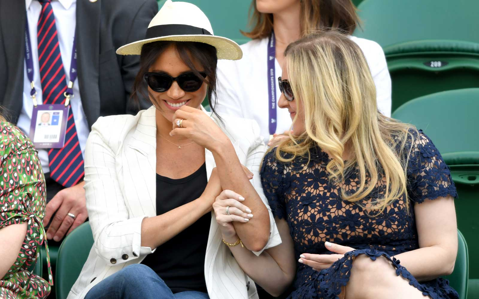 Meghan, Duchess of Sussex (L) attends day 4 of the Wimbledon Tennis Championships