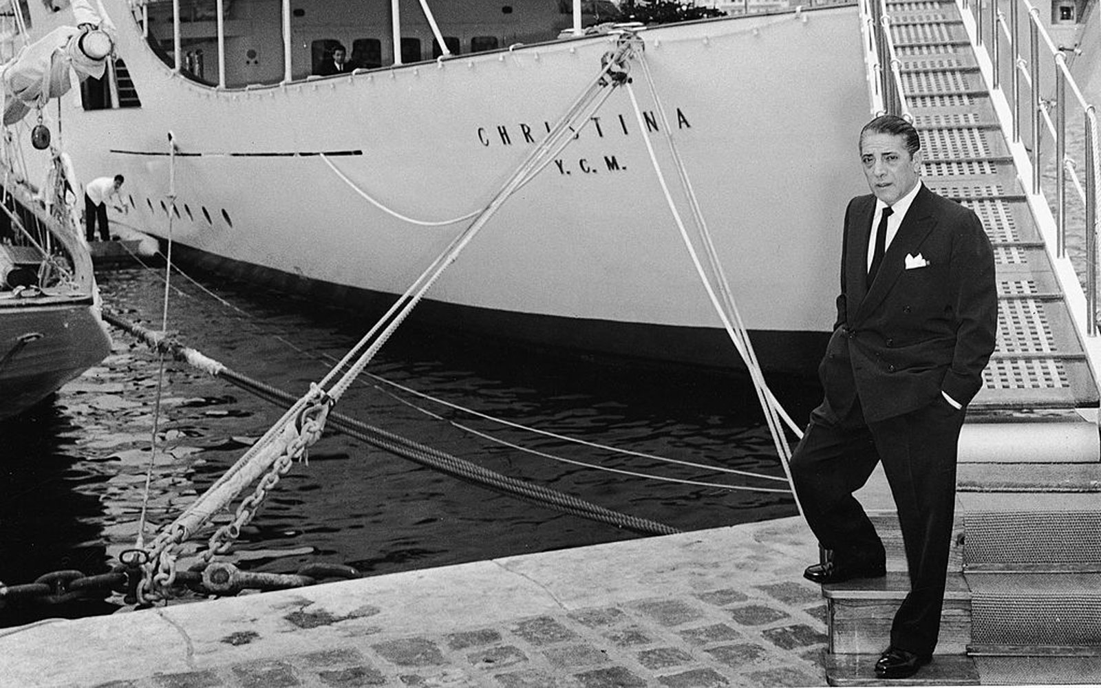 Aristotle Onassis in front of his private yacht in the mid-1950s.