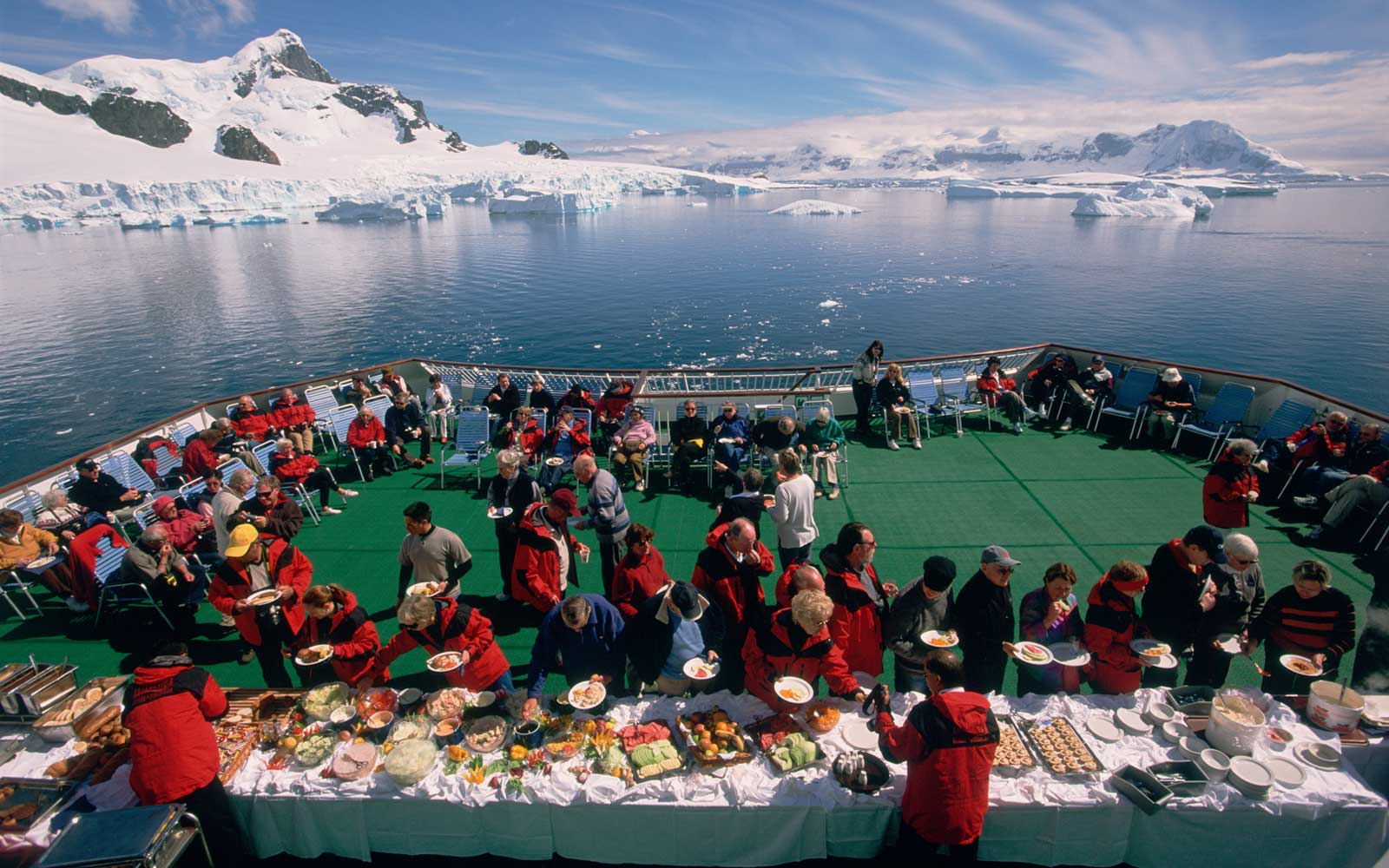 Passengers dine at a buffet line on a cruise ship in Antarctica